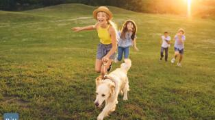 Children and dog enjoying Earth Day