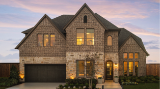 A beautiful move-in ready home by Britton Homes that features a dark brick exterior, natural stone and large rectangular windows.